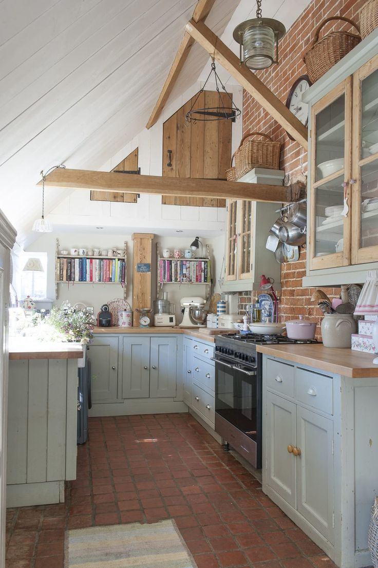 The kitchen sits catslide under the roof at the back of the farmhouse and is made from a host of up-cycled and recycled materials