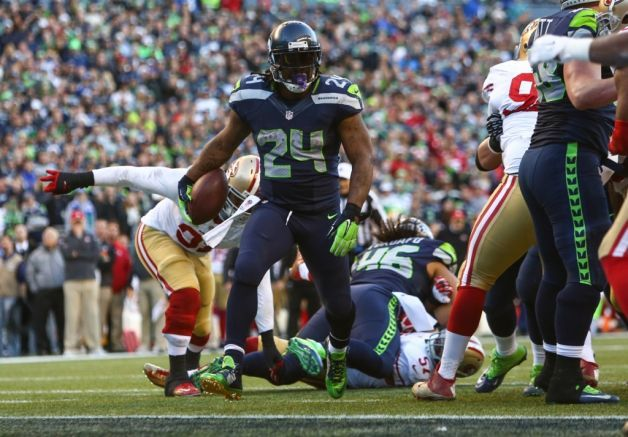 Seattle running back Marshawn Lynch waltzes into the end zone to score a touchdown in the third quarter of the Seahawks' game against the San Francisco 49ers. Photo: Joshua Trujillo, Seattlepi.com