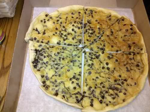 THIS is Chocolate Chip Pizza from Pizza Inn. I love this stuff but alas there is no Pizza Inn in Cali so I am on a mission to try and recreate it! All I know is that it uses a thin crust and uses yellow cake mix, butter and chocolate chips. ( But I don't know if you make a batter first or just use the mix or if there are extra ingredients..) Who wants to help me figure it out?? :)