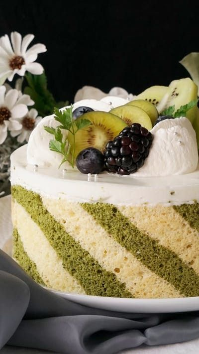 Go fancy for dessert with this light and fluffy striped matcha sponge cake filled with a refreshingly sweet yogurt mousse.