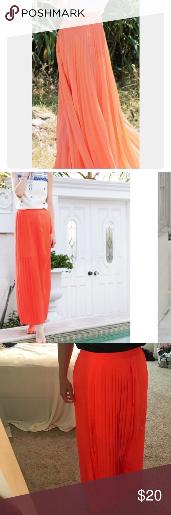 Coral maxi skirt Neon coral maxi skirt with side slit from Shop Stevie! The side slit goes to about the knee. The front is pleated & the waist band is partially elastic. Perfect for tall girls! Skirts Maxi