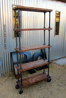 Diy this industrial office shelving on casters with galvanized pipe, plumbing flanges