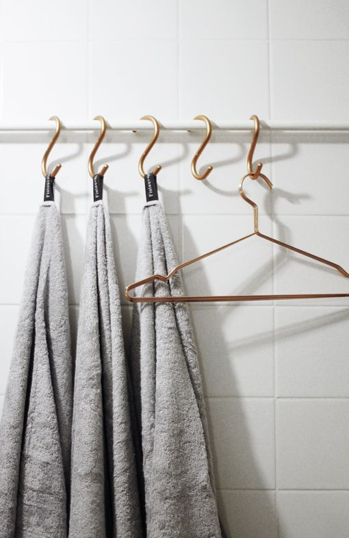 rail + s-hooks for storing bath towels with tags