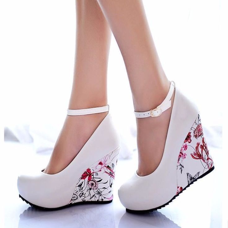Have a greater heights using this floral wedge shoes. This features buckles strap that fasten securely on the ankles, floral print heel, round toe. Crafted from PU, soft leather, rubber, EVA materials More #platformhighheelsfloralprints