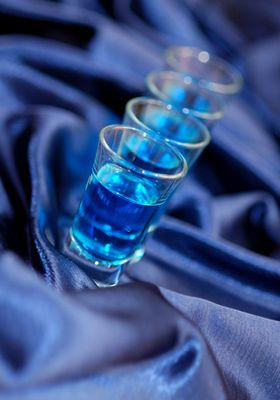 Blue Kamikaze- 1oz vodka, 1 oz blue cuaco liqueur, 1/2 oz lime juice