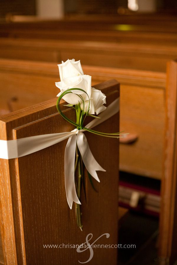 church pew decorations... simple and pretty. I would use Callas instead of roses
