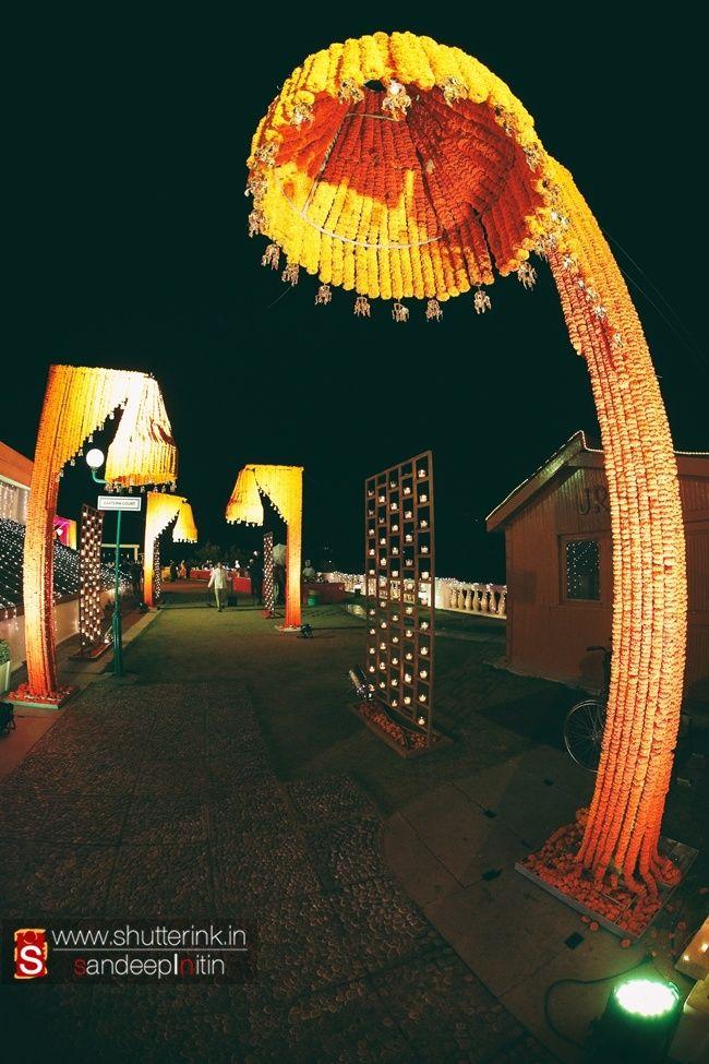 Orange Entrance Decor with Genda Phool Umbrellas