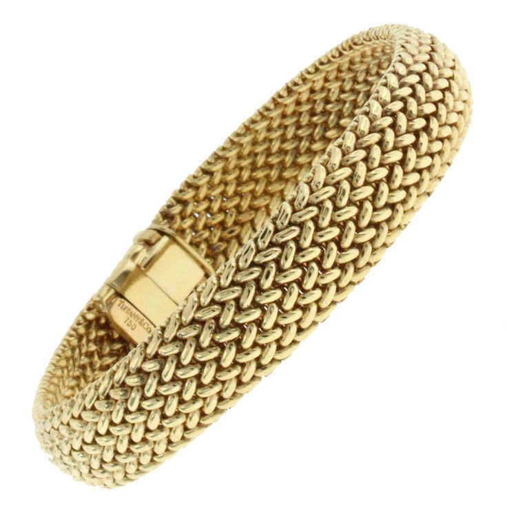 Tiffany & Co. Gold Mesh Bracelet. This Tiffany & Co. mesh bracelet is 9.5 millimeters in width and is 18 karat yellow gold.