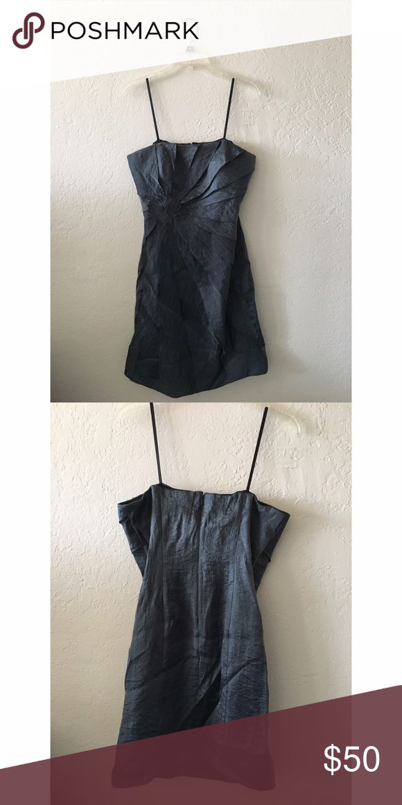 Steel Blue Metallic Formal Dress Iridescent material. Strapless (straps shown in picture are only for hanging garment). Beautiful off-set rose detail. Back zip/hook-and-eye closure. Dresses Prom