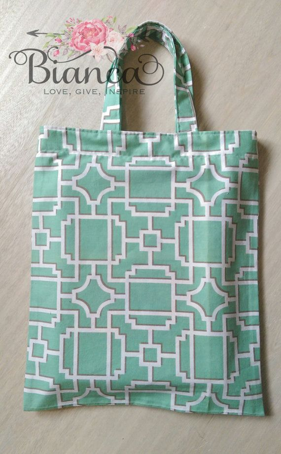 Pretty green book bag https://www.etsy.com/au/listing/247551643/green-tote-library-bag-book-bag-fabric