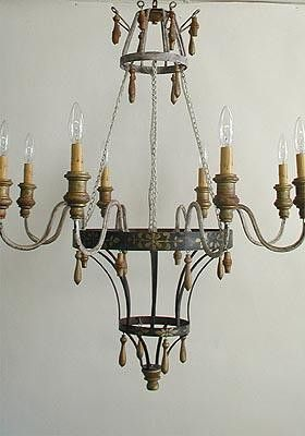 The Chateau Chandelier offers a wonderful combination of rustic, elegance. The rustic wooden drops hang from an antique painted frame, featuring a delicate french toile design. The light fixture is op