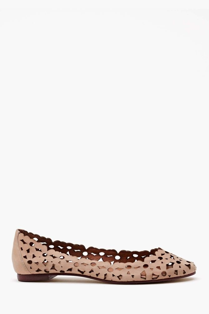 The cutest taupe leather flats featuring a rounded toe and daisy cutout  detailing. Genuine leather