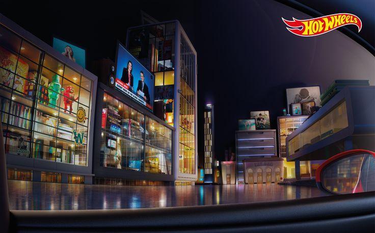 """世界中で人気のミニカーブランド・ホットウィールが、タイで実施したプリント広告をご紹介。 ホットウィールブランドの持つ世界観を端的に伝えるクリエイティブがこちらです。全2種類。 ・キッチン編 ・リビングルーム編 それぞれ広告の受け手が、自動車の運転席に座っているかのような構図のビジュアル。よくよく""""通り""""に軒を連ねている建造物を見てみると、トースターやスムージーミキサーといったキッチンにある用具や、テレビやおもちゃ箱といったリビングルームにあるモノだとわかります。 ホットウィールのミニカーは、「家の中のいたるところで、それぞれの場所ならではの楽しみ方ができます」、「家の中でさえ、子供にとって素敵なドライブスペースに変えてしまいます」、そんなメッセージをコミュニケートしているようです。ノスタルジックを感じさせる"""