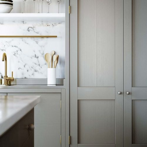 brass-in-gray-kitchen-with-marble