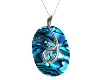 JONZ mother &child pendent,made in New Zealand.A piece of carefully carved New Zealand paua shell from the cold South Pacific Ocean. A fern frond is in the process of opening,like mother caring about the child.