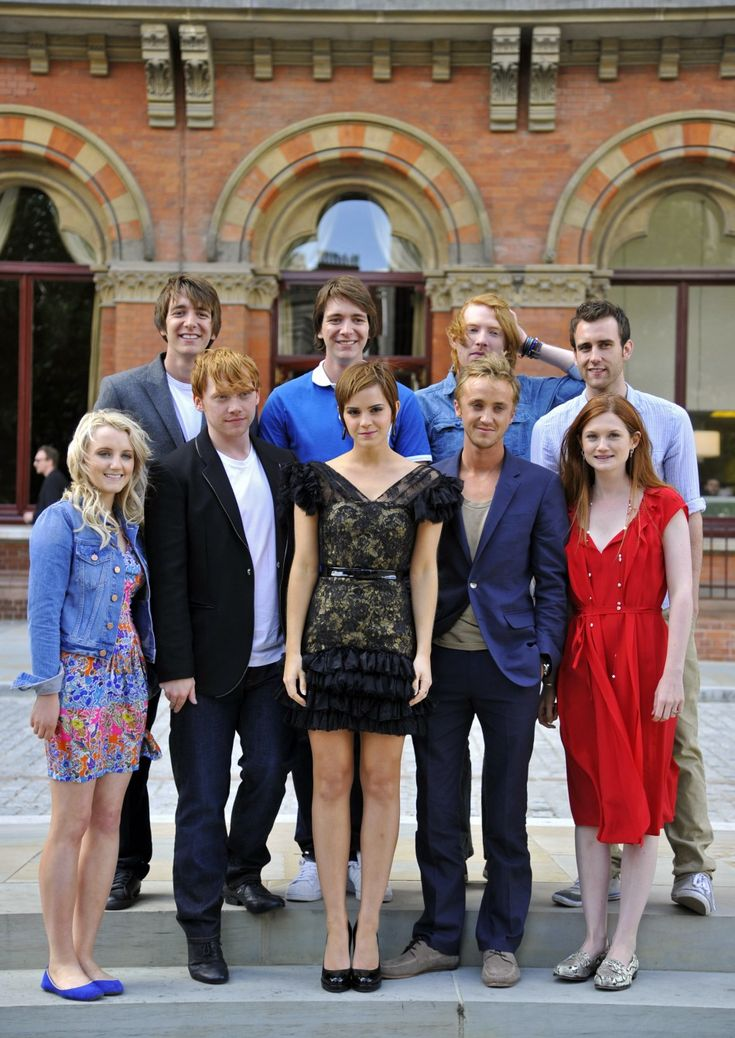 Oliver and James Phelps (The Twins), Domhnall Gleeson (Bill Weasley), Matthew Lewis (Neville), Evanna Lynch (Luna Lovegood), Rupert Grint (Ron), Emma Watson (Hermione), Tom Felton (Draco Malfoy), and Bonnie Wright. (Ginny Weasley)