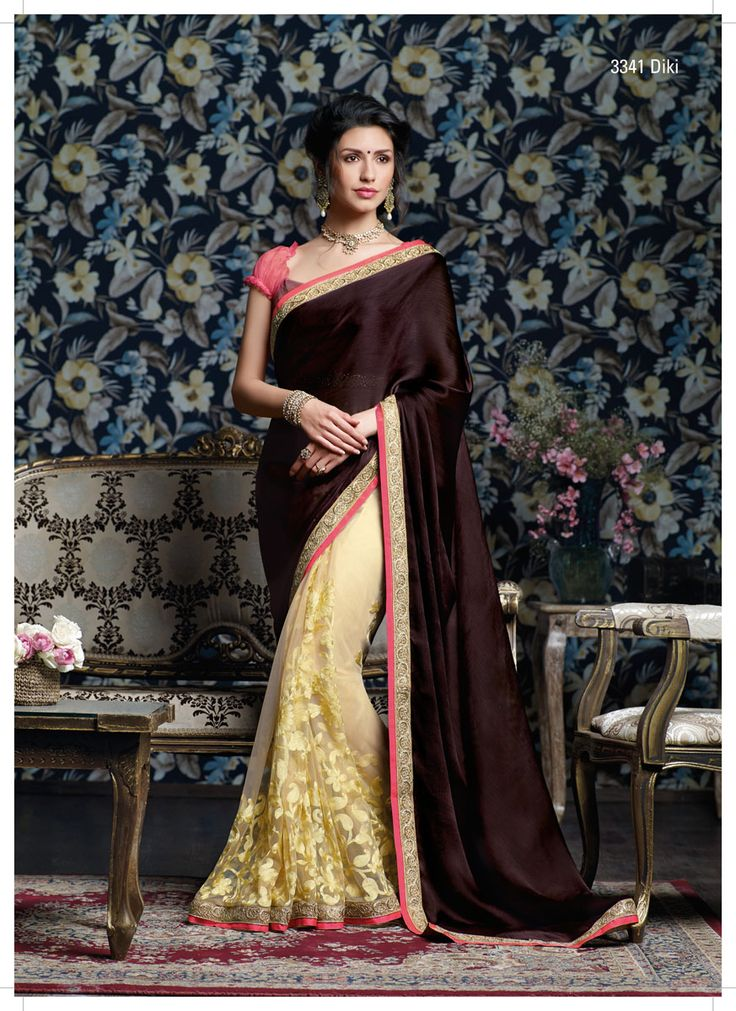 You Rule...! Is the only compliment every woman would get wearing this sensational half – half satin chiffon – net saree with great resham work & diamond studded jari work border.