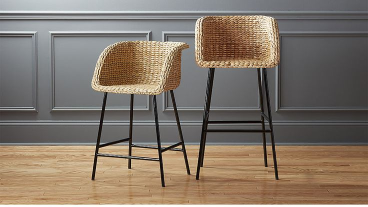 Shop Silas Seagrass Bar Stools.  Natural seagrass forms solid bucket seat that cradles in comfort. Matte black metal legs stand their ground below.