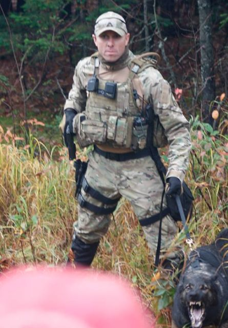 Wow! They're not playing around! He's drawing his gun and everything! (A special ops operative deployed near Moncton New Brunswick in 2013 to defend the fracking operation)