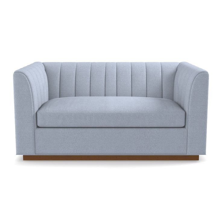 This sleek apartment-size sofahas a tight channel-tufted back that has an art deco flair with a modern silhouette. With high arms and a high back this chairen