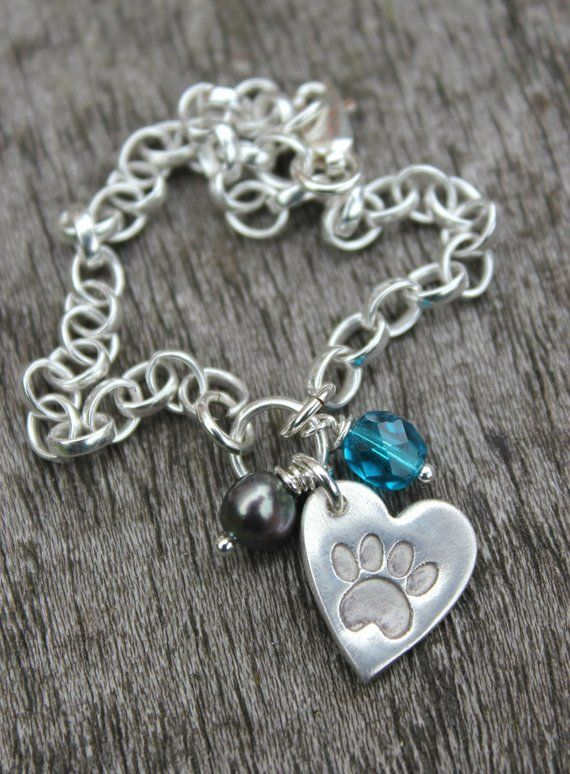22f81bd0e48c5 Pawprint charm bracelet - customised with a peacock freshwater pearl ...