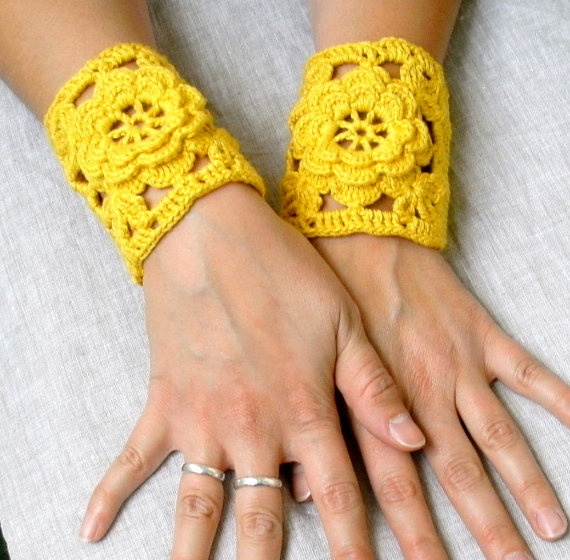Crochet Wrist Warmers.  could combine flower pattern with granny square pattern to create.  Item is no longer sold.