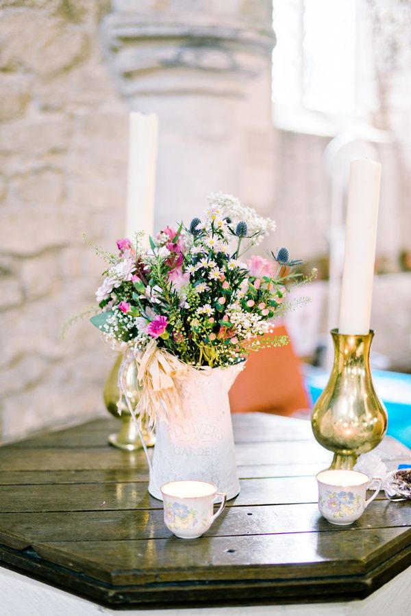 Small Wildflower Arrangement + Ivory Candles | Photography: Andie Freeman Photography. Read More: http://www.insideweddings.com/weddings/intricate-charming-diy-english-garden-wedding-in-peterborough-uk/846/