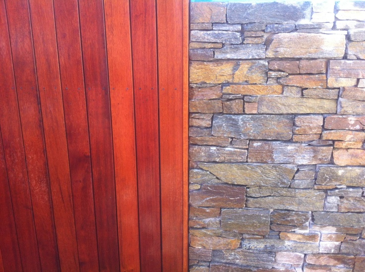 Merbau Decking screen butting up to a drystone wall. Great colour contrasts!