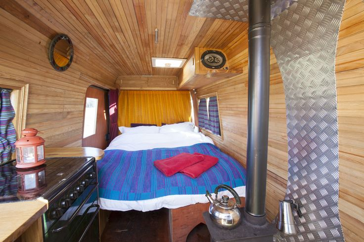 Maya of Bristol - A deliciously comfortable bed surrounded by the most beautiful ash panelling; a cosy woodburner and a full kitchen with oven. What more could you need for the most romantic wedding campervan or adventure honeymoon?