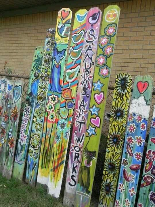 Painted fence posts! I want each of the kids to do one!!! Hm, have each scout paint one? or make the entire fence a group effort?