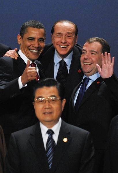 G20 leaders Chinese President Hu Jintao (first row), (2nd row from L to R) US President Barack Obama, Italian Prime Minister Silvio Berlusconi and Russian President Dmitry Medvedev pose for a family photo during the G20 summit at the ExCel centre, in east London, on April 2, 2009. World leaders meet Thursday for a crunch summit of the Group of 20 richest nations aimed at fixing the crisis-wracked global economy.