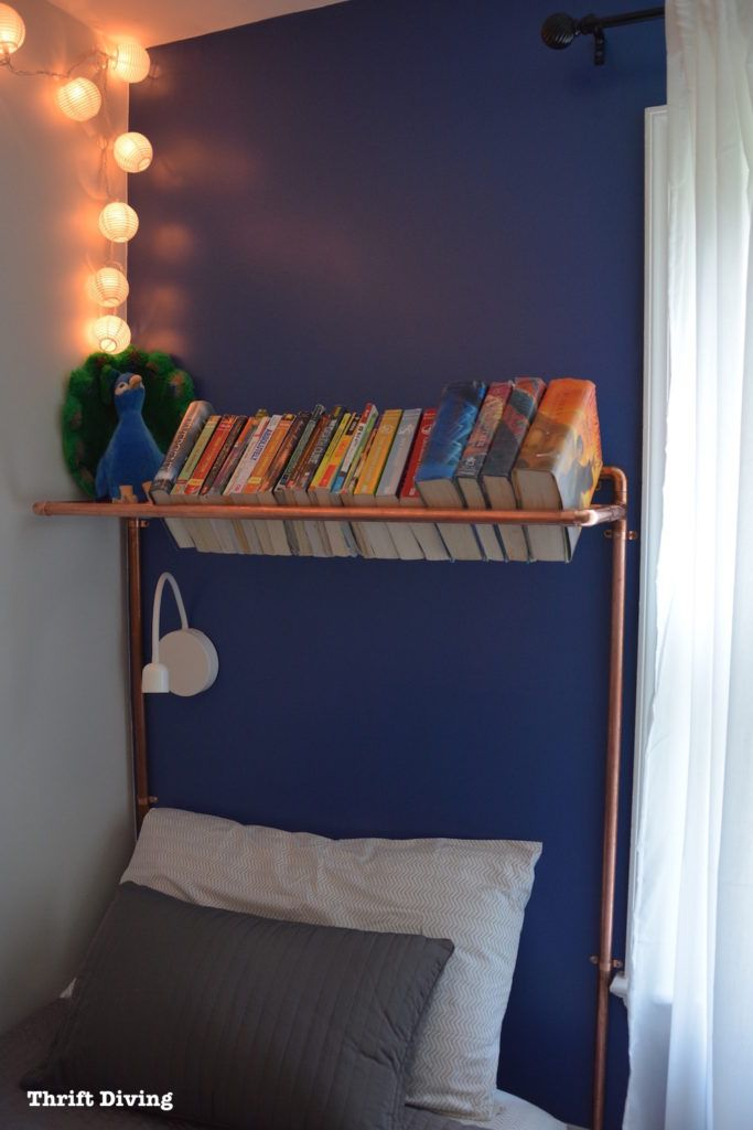Build a DIY copper pipe headboard over a child's bed and fill it with books. Get the full project tutorial on the blog! - Thrift Diving