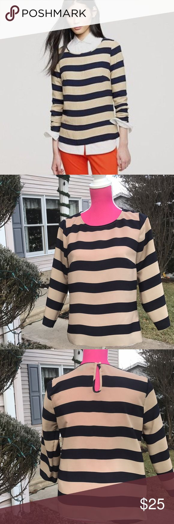 ⚓️J. CREW⚓️ nautical navy and Beige striped blouse Very pretty 100% polyester material J. Crew blouse. Navy and Beige/tan stripes with a keyhole and button at back of neck. No signs of wear. Size small. J. Crew Tops Blouses