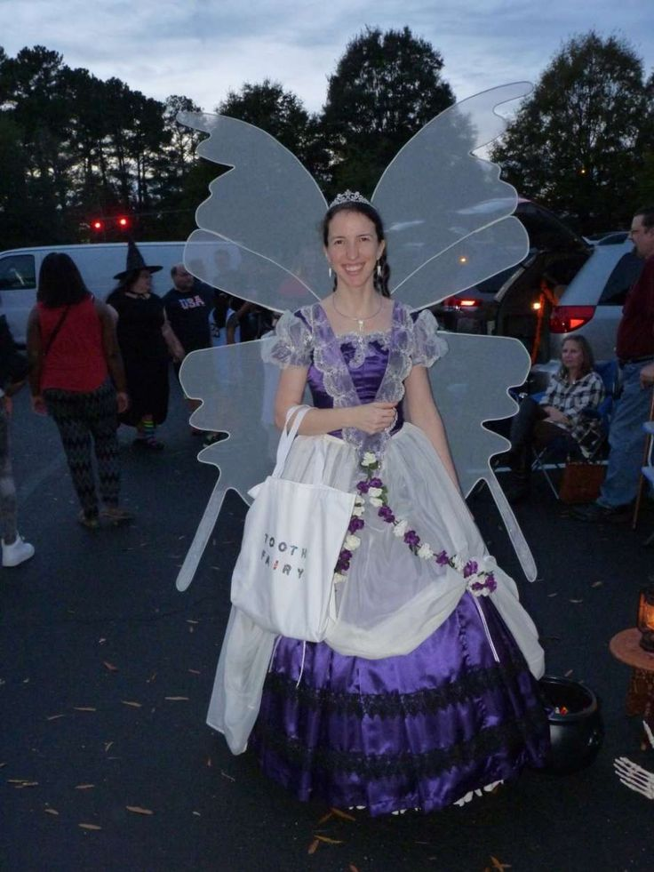 I designed this costume myself, and I am the one wearing it. One picture includes my friend's two children. I used to be a dental assistant, so I thought it would be fun if I were the tooth fairy. (I couldn't wear the costume to work, though, because it would get in the way too …