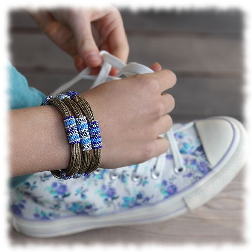 Three beadwork bracelets in blue