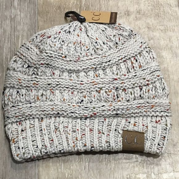 Confetti Oatmeal- Slouchy Knit Beanie Keep warm while looking ADORABLE! Super cute confetti beanie with C.C label on it. Adorable, slouchy, thick knit, and supersoft. Price is firm. Lots of colors available. Check other listings. CC Beanie. cc beanie. Not Chanel CC Beanie Accessories Hats