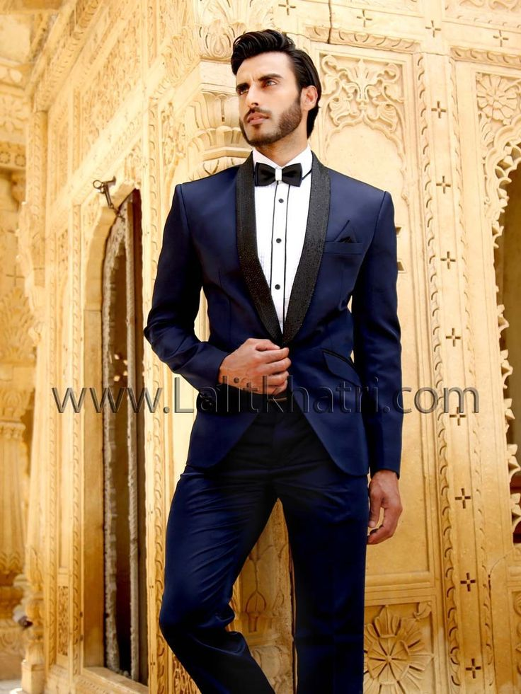 Spectacular navy blue color shawl lapel tuxedo designed on imported fabric with pocket flap and centre button. item Code : TSP2602 http://www.lalitkhatri.com/label/men.html