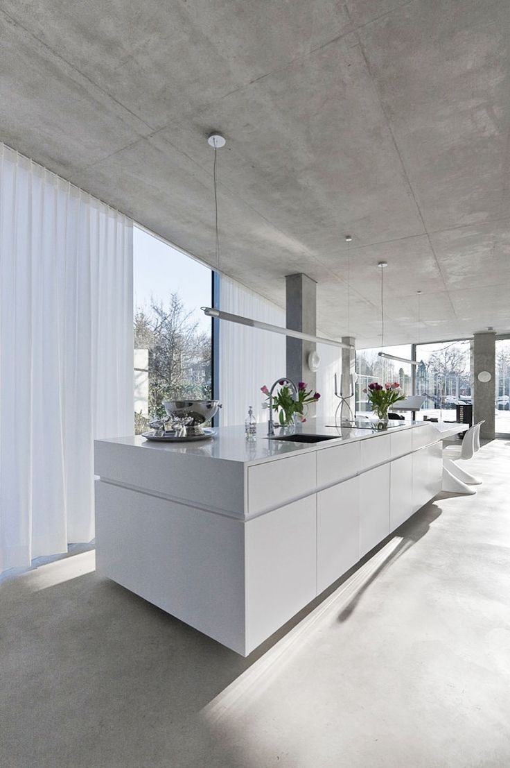 floating kitchen in glass home designed by Wiel Arets Architects.  Note island…