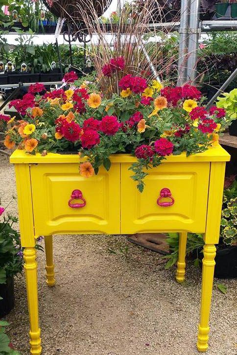 Kelly from Soul Patina repurposed an unused sewing cabinet into a bright and cheery planter. It was painted with GF Sunglow Yellow Milk Paint and sealed with Exterior 450 top coat.
