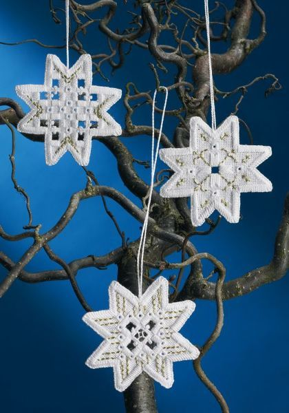 Three pretty cross stitch Christmas tree decorations in white with a touch of gold glitter.