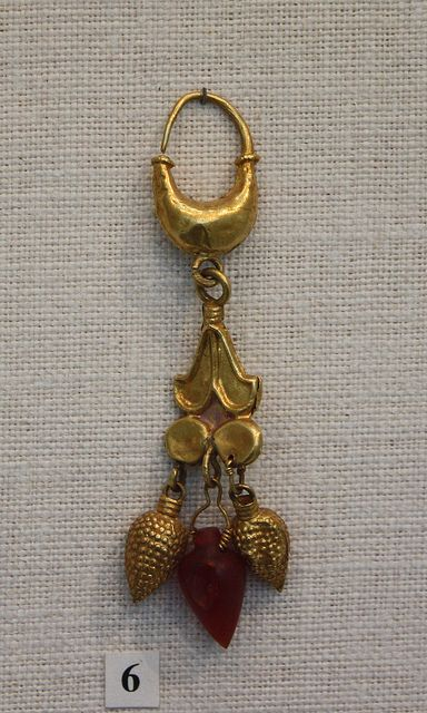 Gold earring with carnelian lotus flower pendant Greek, Cypriot, 6th–5th century BCE |
