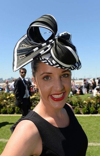 Lucy Hoolihan, showing off her hat at the Victorian Derby Day at Flemington. 2nd November 2013.