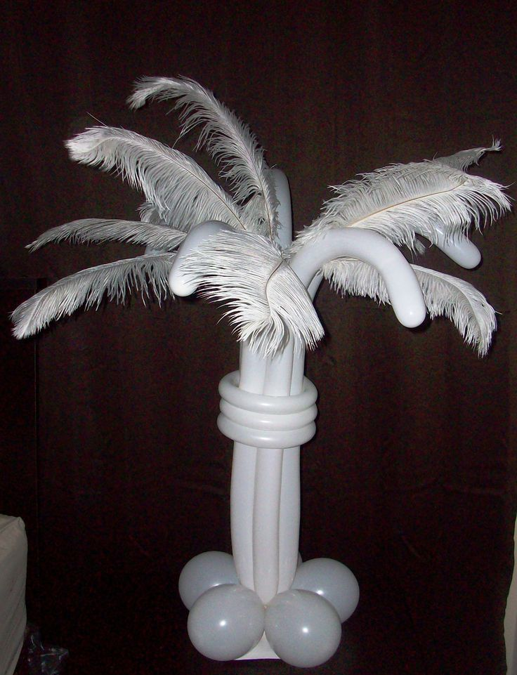 Fantasy Feathers- Beautiful for weddings and other formal affairs, this centerpiece features a combination of balloons and feathers that are easily customized in the event colors.