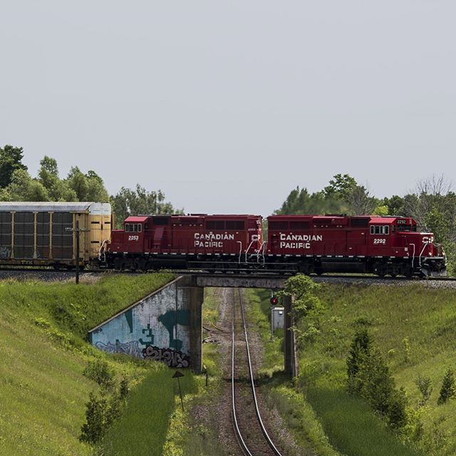 A Pair Of GP20C-ECO Lead A Local Autorack Train From The