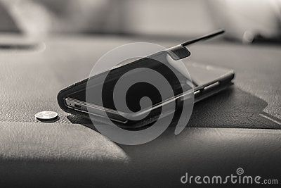 Mobile phone in car and money.