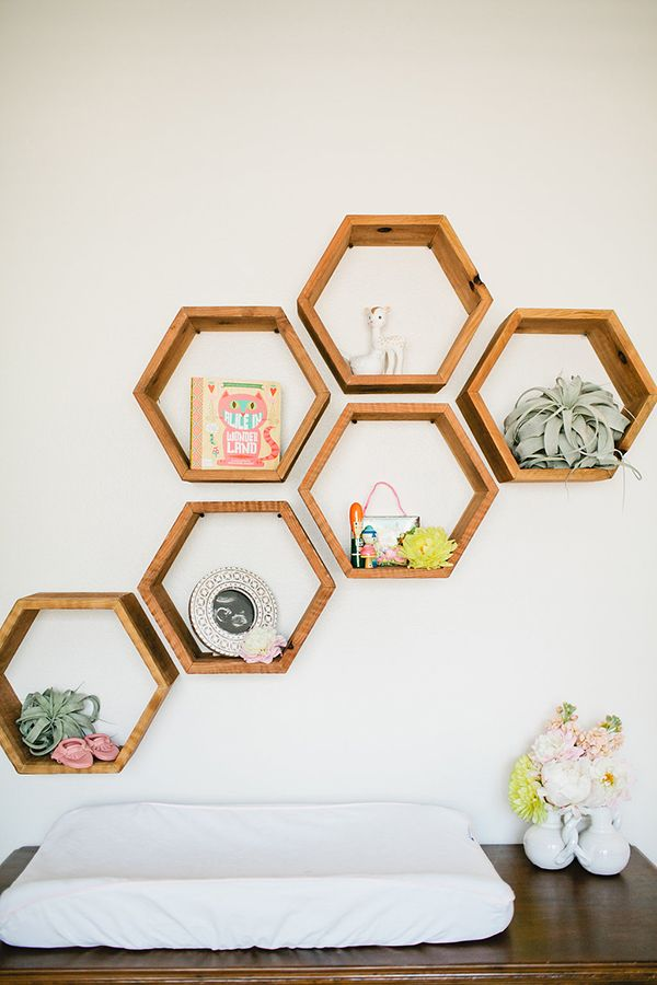 what about a set of hexagon shelves in the dining room (west/north wall nook area)? this set is from an Etsy shop.