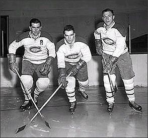 With Moore at left wing, 'Rocket' Richard at right and centred by Maurice's younger brother Henri, the Montreal Canadiens made hockey history, winning five consecutive Stanley Cup championships between 1956 and 1960.