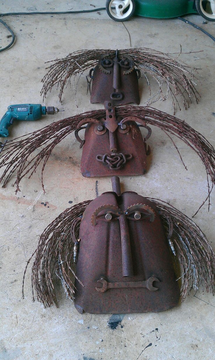 Shovel faces barb wire scrap metal art