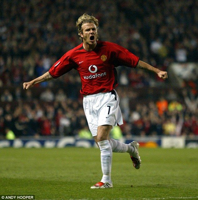 David Beckham celebrates scoring Manchester United's third goal against Real Madrid in 2003 at Old Trafford