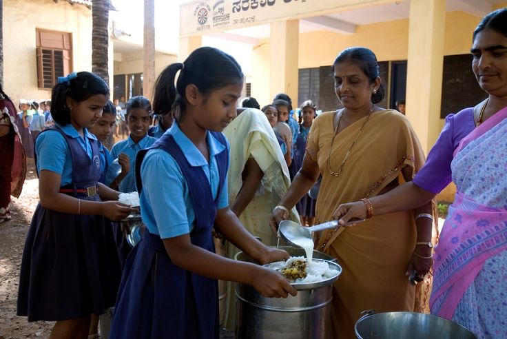 Teachers at Hubbali government school are distributing the mid-day meal to #children. All the students will be served with sufficient food by the #teachers.